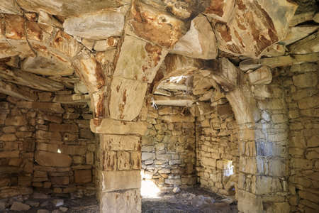 The interior of housing with pillars supporting ceiling in historical abandoned village of Gamsutl located on a remote mountain peak in the Republic of Dagestan, Russia Zdjęcie Seryjne