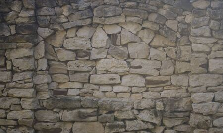 The old fence, made of natural stone gray. Masonry texture Stockfoto - 133466989