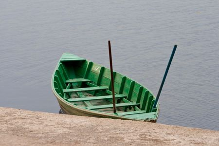 green boat: Green boat on the berth