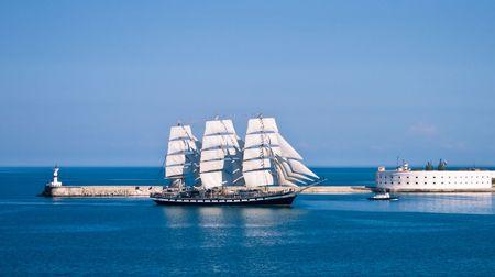 Sailboat entering the bay. Ukraine Sevastopol  Stock Photo - 6264594