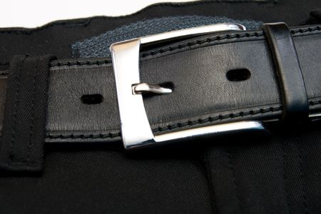buttoned: Buttoned strap on black jeans  Stock Photo