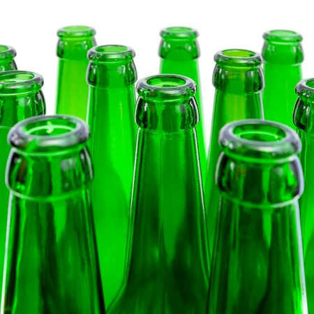 Beer bottles of green glass on a white background photo