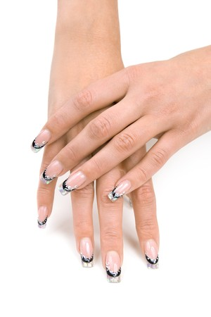 Womens hands with a nice manicure. Isolated on white background. photo