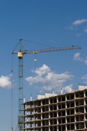 Building.  Crane towering over the concrete structure. Stock Photo - 7792593