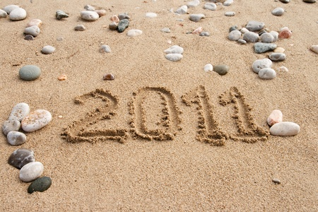 The inscription on the sand with the designation in 2011 Stock Photo