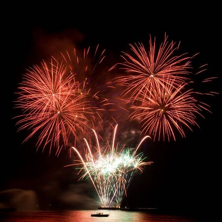 Colorful fireworks in the night sky and reflecting on the water Stock Photo - 8434453