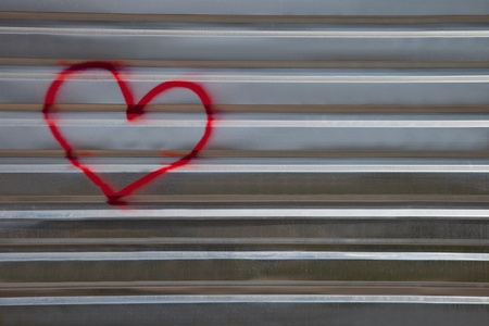 Graffiti, an abstract image of the heart on a metal fence photo