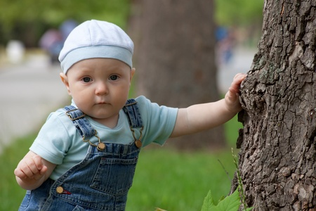 Portrait of a happy little boy in a cap and jeans Stock Photo - 9871437