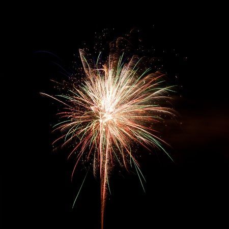 The explosion of fireworks in the night sky Stock Photo