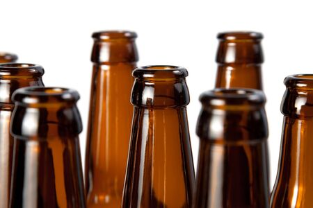 The necks of beer bottles brown glass isolated on white photo