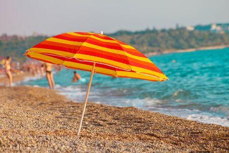 brolly: Beach umbrella against the the coastline Stock Photo