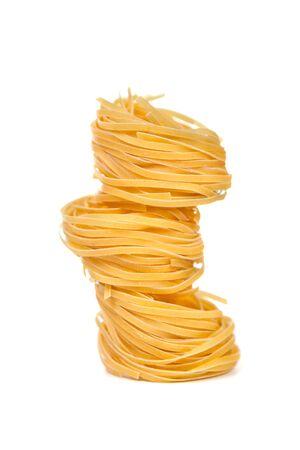 Pasta products nests. Isolated on white background  photo