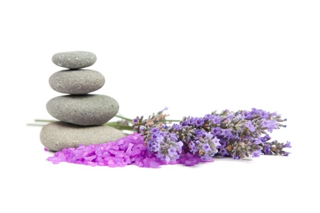 sprigs: Spa background. Sprigs of lavender, bath salt, pebbles for stone therapy. Isolated on a white background