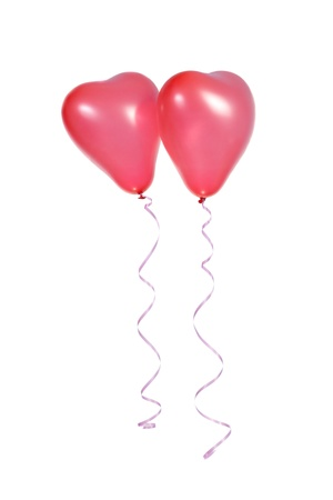 Two red balloons in the shape of a heart on a white background