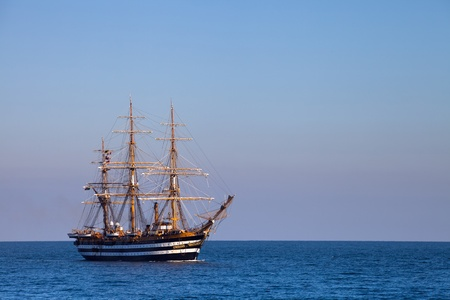 A beautiful three-masted sailboat in the open sea photo