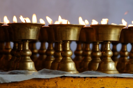 candleholders: Candleholders with burning candles in Indian temple
