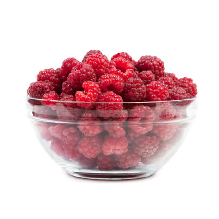 Dish with raspberries. Isolated on white background photo