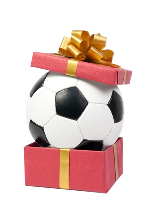 Soccer ball in a gift box. Isolated on white background.  photo