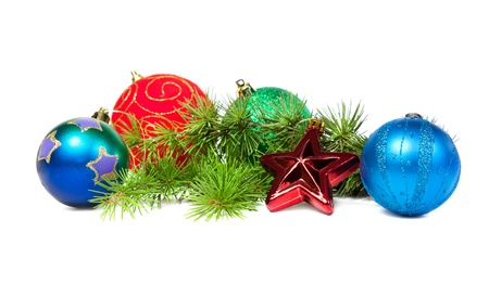 Christmas decorations and fir branch isolated on white background photo