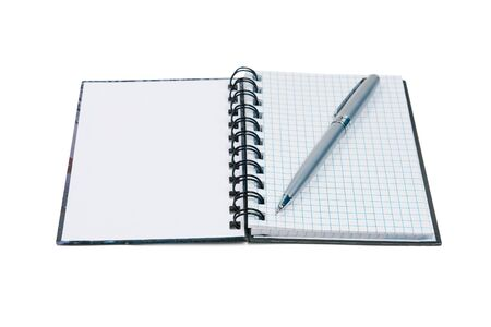 Open notepad and pen. Isolated on white background photo