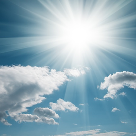 A blue sky with clouds and bright sun Stock Photo