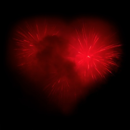 Fireworks in the night sky in the form of heart  photo