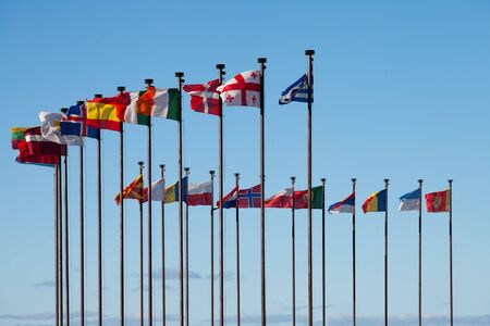 flagpoles: Flags of different countries are developing on the flagpoles  Stock Photo