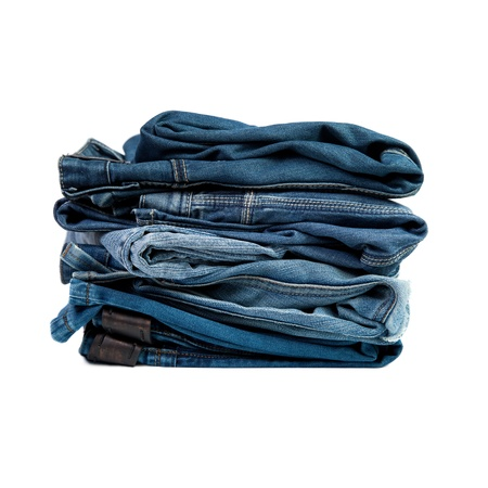 Jeans things stacked stack. Isolated on white background photo
