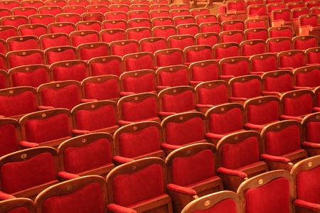 Rows of red chairs at the theater photo