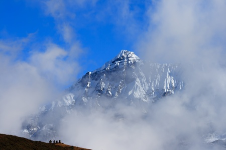 The high snow capped mountains in the clouds Stock Photo - 13008315