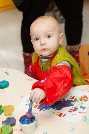A child learns to paint finger paints Stock Photo - 13008318
