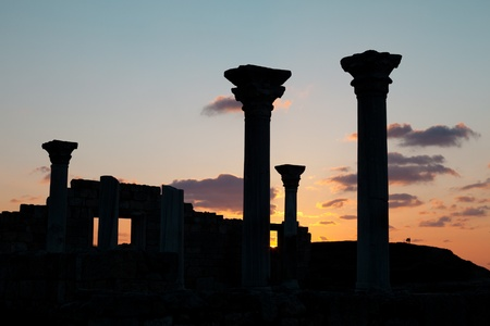 Ancient ruins in the background of the sunset sky photo