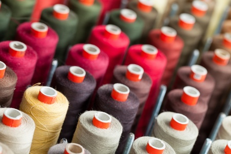 Background of the reels with colorful threads photo