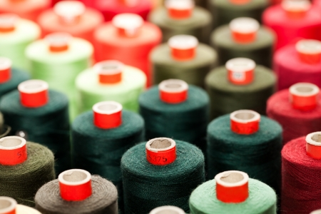 Background of the reels with colorful threads  Stock Photo