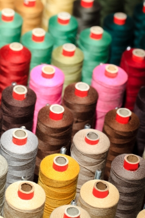 sewing item: Background of the reels with colorful threads  Stock Photo