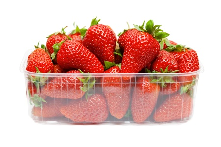 Strawberries in plastic packaging, isolated on white background
