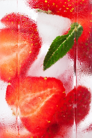 Background of the misted glass with a strawberry cocktail  photo
