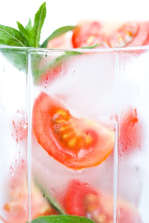 Background of the misted glass with a tomato cocktail photo