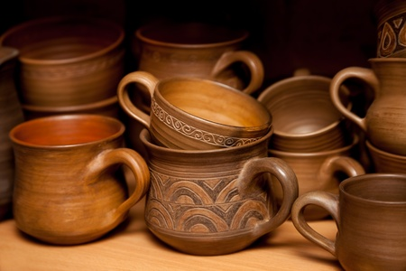 Crockery handmade from clay cups and jugs photo