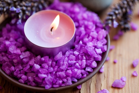 Spa background, candle in a saucer with salt baths and sprigs of lavender  版權商用圖片