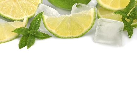 Lime with pieces of ice and mint leaves  isolated on white background