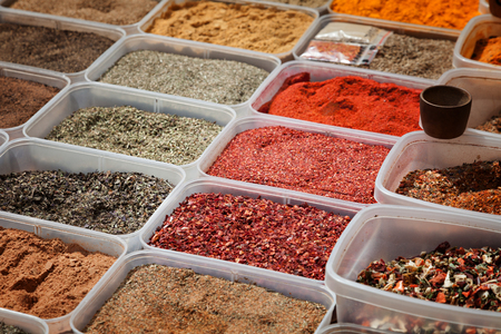 Colorful spices in plastic containers photo