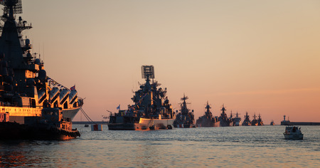 Warships in the wake ranks at sunset