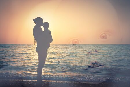 Double exposure, Silhouette of mother and child on the beach, and a child's face photo