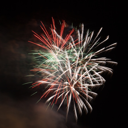 fireworks on white background: Outbreaks of fireworks in the night sky Stock Photo