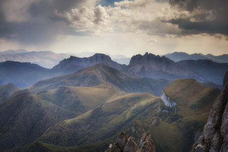 ridges: Landscape. Mountain ridges at against the sky with clouds Stock Photo