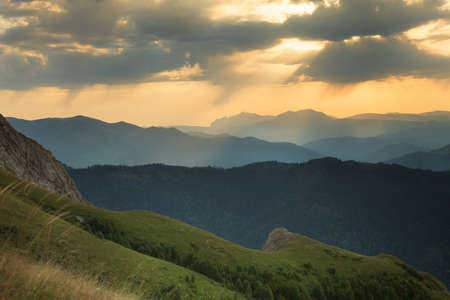 ridges: Landscape. Mountain ridges at sunset against the sky with clouds