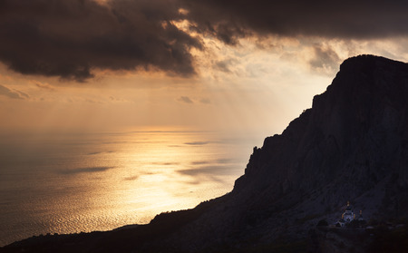 Small church under a mountain at sunset. Russia, Crimea, Foros.