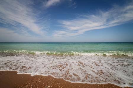 oceanside: Landscape. Oceanside under blue sky with clouds