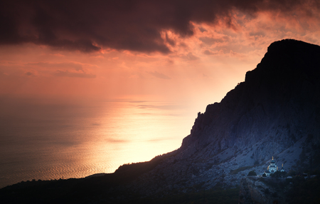 Small church under a mountain at sunset. Foros. Crimea. Stock Photo
